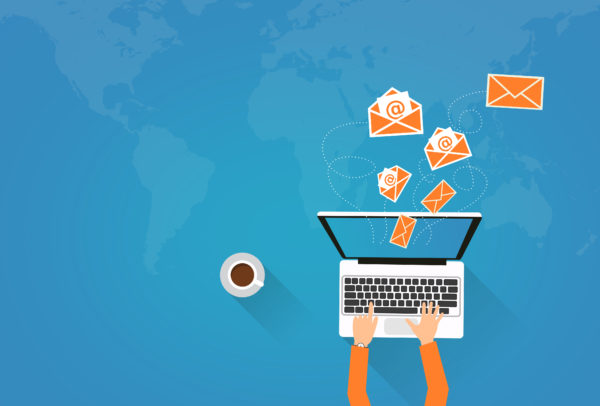 Email Marketing - Person on Laptop Sending Virtual Envelopes
